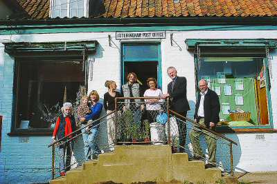 Norman Lamb MP visiting the shop in October 2003
