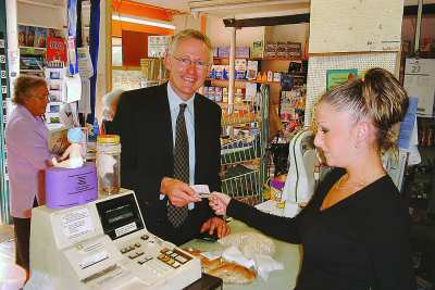 Norman Lamb MP being served by Holly Turner Oct 2003