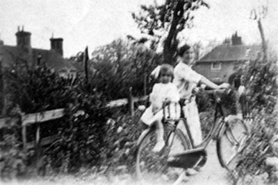 Yvonne Winifred Baxter on bicycle c.1926