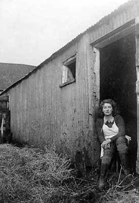 Nancy Lusher at the cow stalls - January 1943
